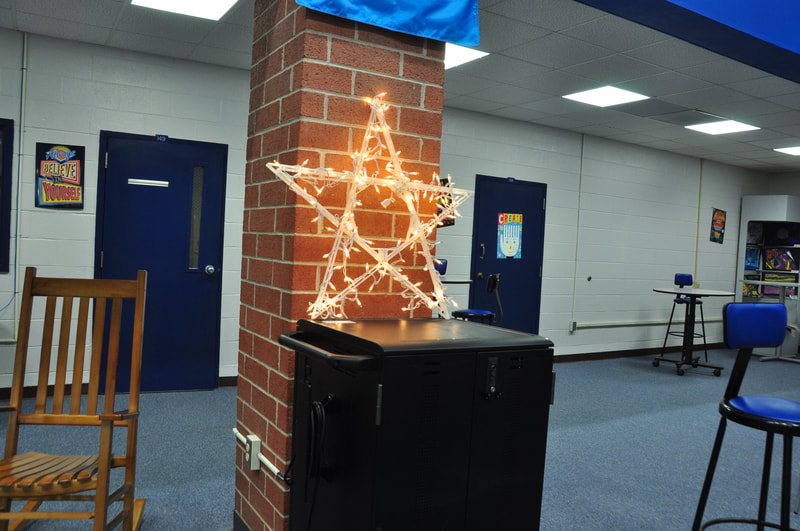 An illuminated star atop a Chromebook cart