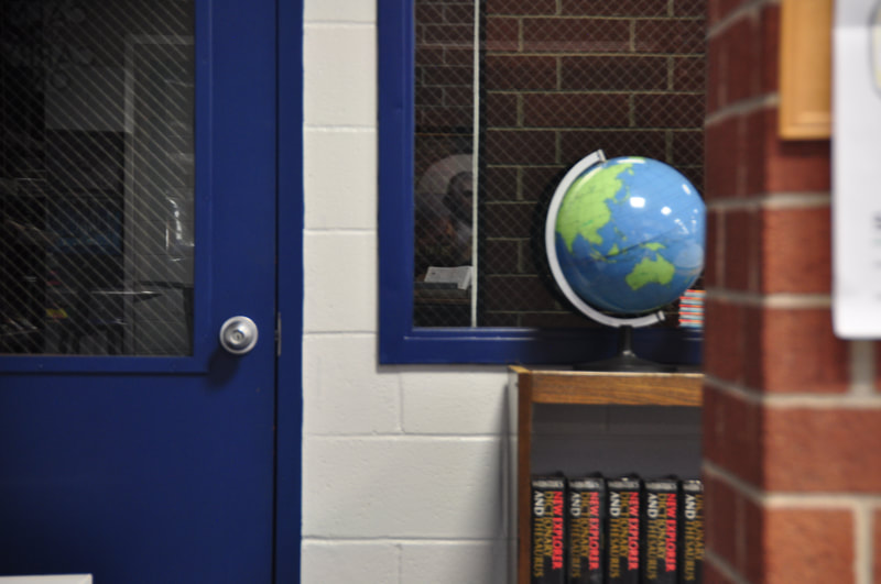 A globe in front of a classroom window