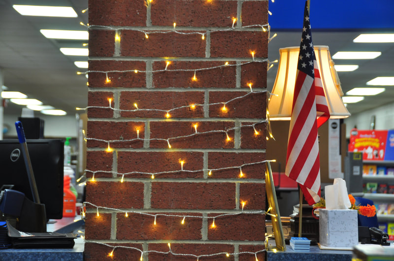 Lights wrap a brick column